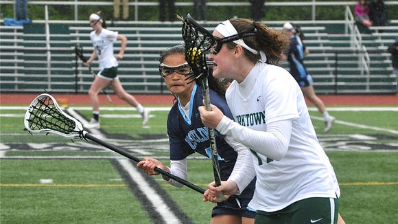 Lia Tunney of Ursuline (in blue) races up the field with Yorktown's Caroline Keenaghan (r). Photo from May 19, 2018.