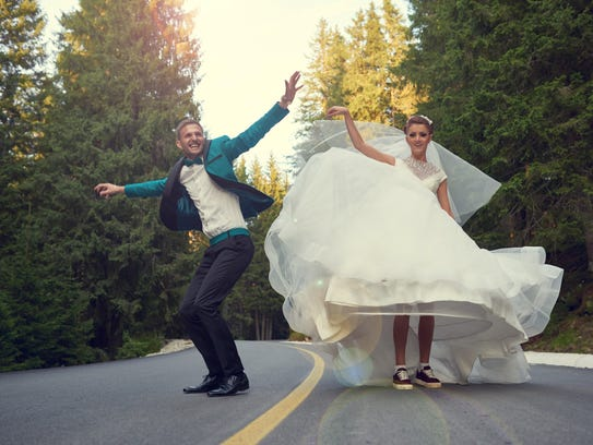 Bride and groom jumping, running and feeling great