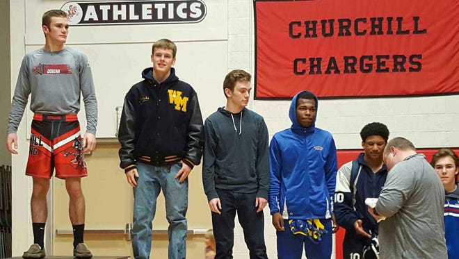 Chase Gardner is pictured at the top of the medal podium after placing first at 152 pounds in Saturday's Observerland Tournament.