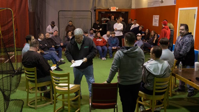Holbrook Little League board at meeting where they  discussed with parents and members of the community, financial mismanagement and the resignation of former president and treasurer.