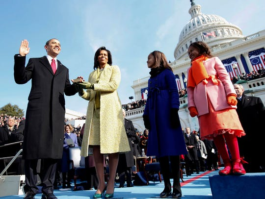 In this Jan. 20, 2009, file photo, Barack Obama, left,