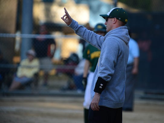 Mardela's Head Coach Kory Shiles gives out the signals against St. Michaels on Tuesday, May 8, 2018 during the Bayside Championship at the Henry S. Parker field in Salisbury, Md.