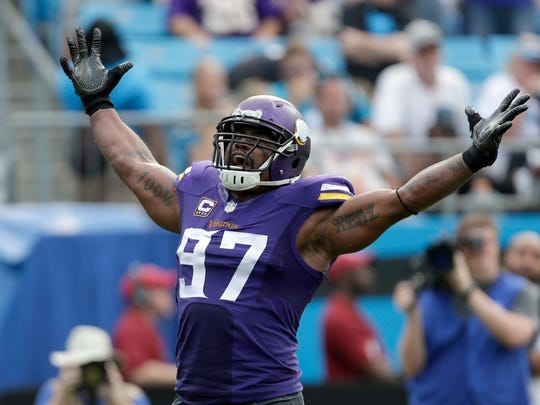 Minnesota Vikings' Everson Griffen (97) celebrates after a sack against the Carolina Panthers in the second half of an NFL football game in Charlotte, N.C., Sunday, Sept. 25, 2016. The Vikings won 22-10.