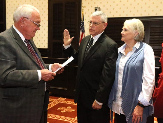 Rutherford County Sheriff Mike Fitzhugh is sworn into office by County Mayor Ernest Burgess.