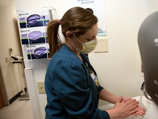 Kirsten Shoop, LPN, washes her hands while working