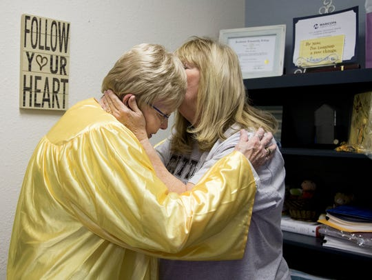 Gwendolyn Carlson (left), 84, gets a kiss from her