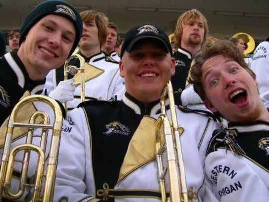 Chris Momcilovich, center, played trombone for the
