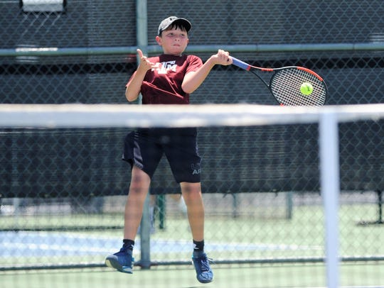 Wylie Junior High's Trevor Short hits a shot during the USTA Texas Slam at Wylie High School on Monday. Short won 6-3, 6-4 to advance in the Boys' 12 consolation bracket.