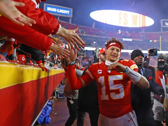 Jan 12, 2020; Kansas City, Missouri, USA; Kansas City Chiefs quarterback Patrick Mahomes (15) celebrates with the fans as he leaves the field after defeating the Houston Texans in the AFC Divisional Round playoff football game at Arrowhead Stadium. Mandatory Credit: Mark J. Rebilas-USA TODAY Sports