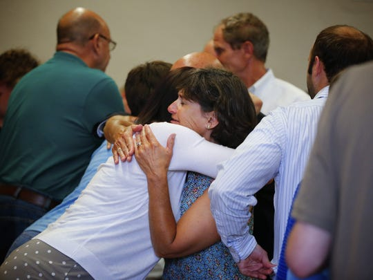 Justin Michael's fiance, Angie Ver Huel, hugs Michael's mother, Marie, after David Moffitt was found guilty of murdering Justin Michael Wednesday, July 1, 2015.