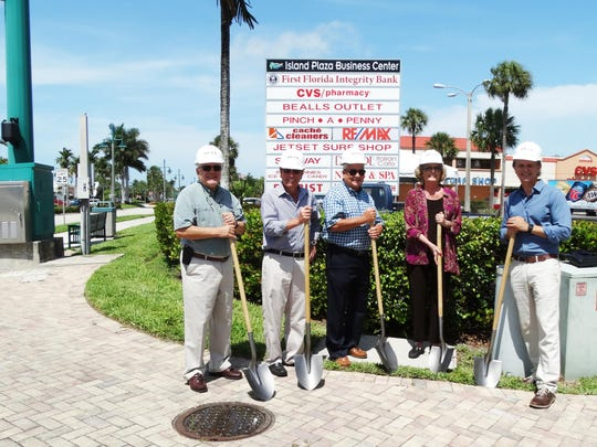 Participants break ground for improvements at Island Plaza at Collier Boulevard and San Marco Boulevard on Tuesday.