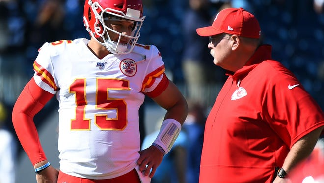 Nov 10, 2019; Nashville, TN, USA; Kansas City Chiefs quarterback Patrick Mahomes (15) talks with head coach Andy Reid before a game against the Tennessee Titans at Nissan Stadium.