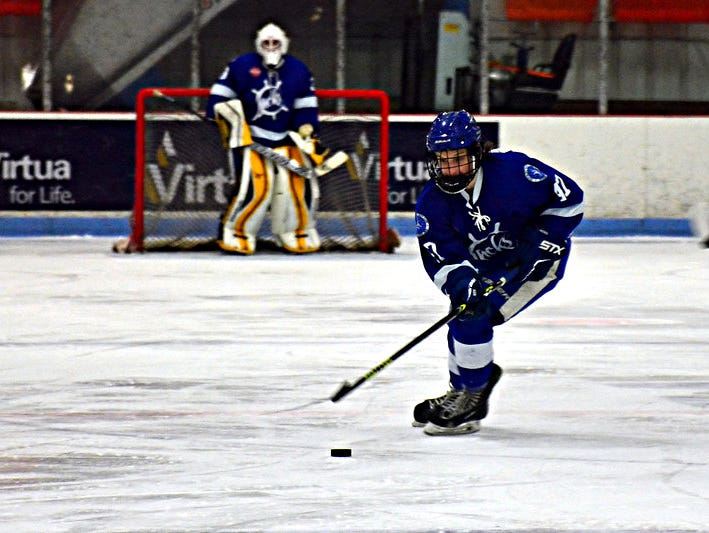 Former Hendersonville High defenseman Lucas Bahn brings the puck up the ice during a game that he played with the Skipjacks (Mary.) Hockey Club this past season.