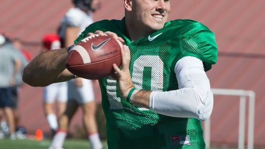 Chad Kelly warms up before practice begins in August.