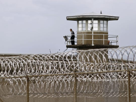 A correctional officer mans a tower at the Oregon State Penitentiary April 27, 2011.