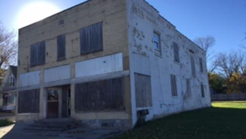 This blighted building in Old Town is tied to a lawsuit an East Lansing developer filed against the city and three City Council members. Sam Saboury wants to put 23 low-income rental units in that area as part of mixed-use project.