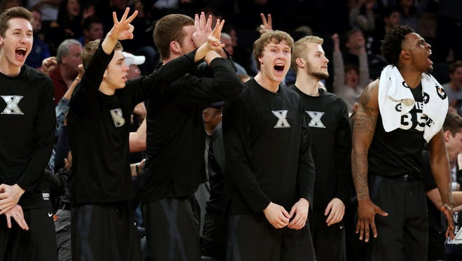 The Xavier bench celebrates after J.P. Macura hit a three-pointer to give the Musketeers a 65-64 lead in the semi-finals of the Big East Conference Tournament in New York City Friday March 10, 2017. Xavier lost 72-75.