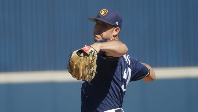 Brewers' Jacob Barnes throws during a spring training game.