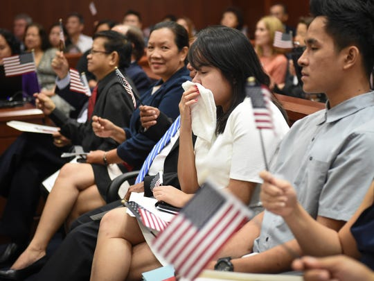 "From right, brother and sister Raynan and Reham Macaalay celebrate their new U.S. citizenship at a ""Let Freedom Ring"" naturalization ceremony at the District Court of Guam on Jan. 20. The Macaalays were among 32 new citizens from five countries sworn in during the ceremony."