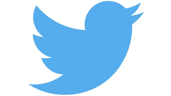 Twitter logo of blue bird flying and singing.