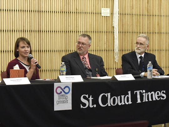 Katie Cashman, Scott Staska and Walter Roberts Jr. speak on a panel in September 2015 about what the community can do to reduce and prevent bullying.