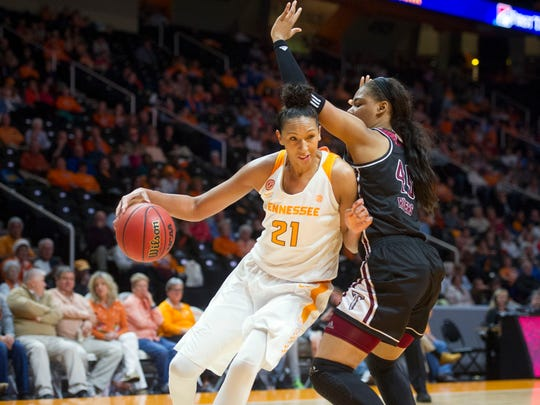 Tennessee's Mercedes Russell, left, drives against Troy's Amber Rivers on Wednesday at Thompson-Boling Arena.