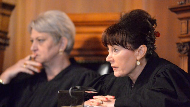 Kentucky Supreme Court Justice Michelle M. Keller, right, listens to the response to a question during oral arguments in a case that seeks clarification on what a judge is allowed to do when a jury lacks diversity Thursday in the Kentucky Supreme Court Courtroom in Frankfort, Ky. (Timothy D. Easley/Special to the C-J)