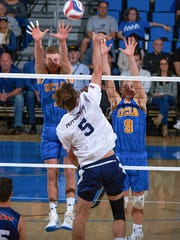 UCLA's Mitch Stahl, left, and JT Hatch, right, go up for a block earlier this season. Stahl is a 2013 Chambersburg graduate and will be playing with UCLA at Penn State next week in the NCAA championships.