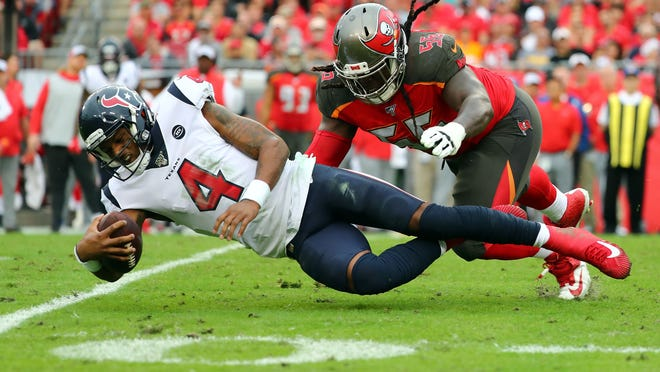 Dec 21, 2019; Tampa, Florida, USA; Houston Texans quarterback Deshaun Watson (4) runs with the ball as Tampa Bay Buccaneers defensive tackle Rakeem Nunez-Roches (56) defends during the second half at Raymond James Stadium. Mandatory Credit: Kim Klement-USA TODAY Sports