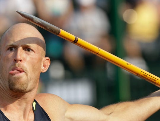 Tom Pappas prepares to throw his javelin in the decathlon