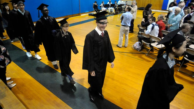 Oakwood Friends School candidates for graduation walk into the gymnasium on Friday during commencement ceremonies on campus in the Town of Poughkeepsie.