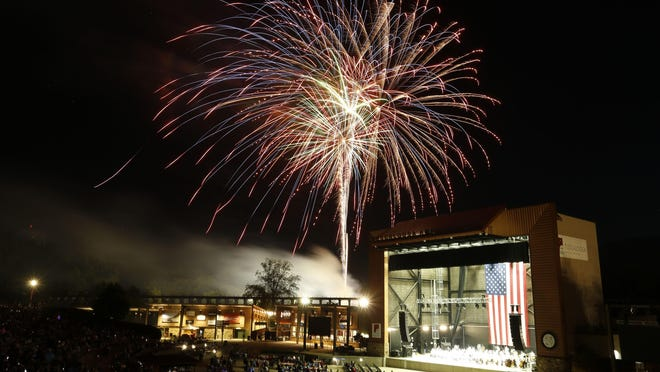 Fourth of July celebrants enjoy the fireworks show from inside the Tuscaloosa Amphitheater Thursday, July 4, 2019.