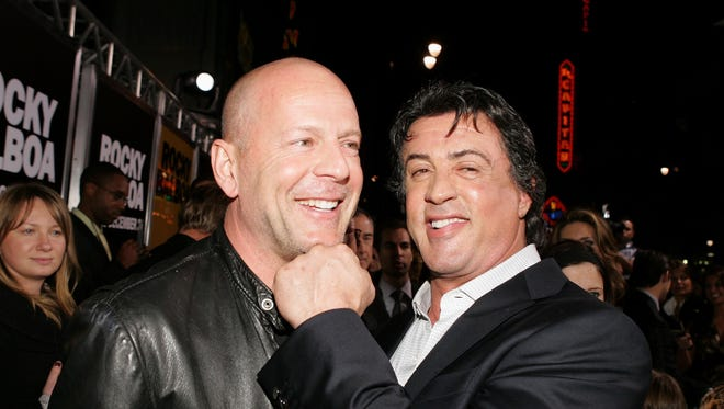 Bruce Willis and Sylvester Stallone joke around in Hollywood at a 2006 movie premiere.