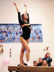 Northville senior Emma Cemalovic performs on the balance beam.
