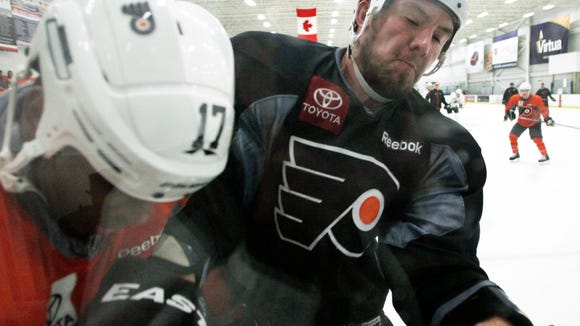 The Flyers used to practice with Toyota patches on
