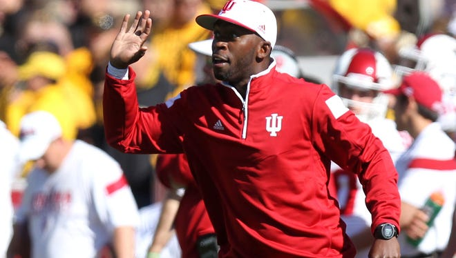 Indiana Hoosiers running backs coach Deland McCullough signals to his team during a game against the Iowa Hawkeyes at Kinnick Stadium in October of 2014.