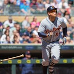 Detroit Tigers first baseman Miguel Cabrera (24) doubles in the fourth inning against the Minnesota Twins at Target Field.