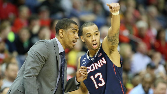 Coach Kevin Ollie and point guard Shabazz Napier have led UConn to the Elite Eight.