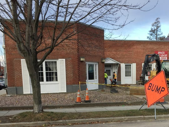 The view from South Union Street: Construction workers on Monday enter the former Corbin & Palmer funeral home that is being converted into a Folino's pizza restaurant, a Stonecutter Spirits tasting room and a new bagel cafe named Willow's. Photographed Nov. 20, 2017.