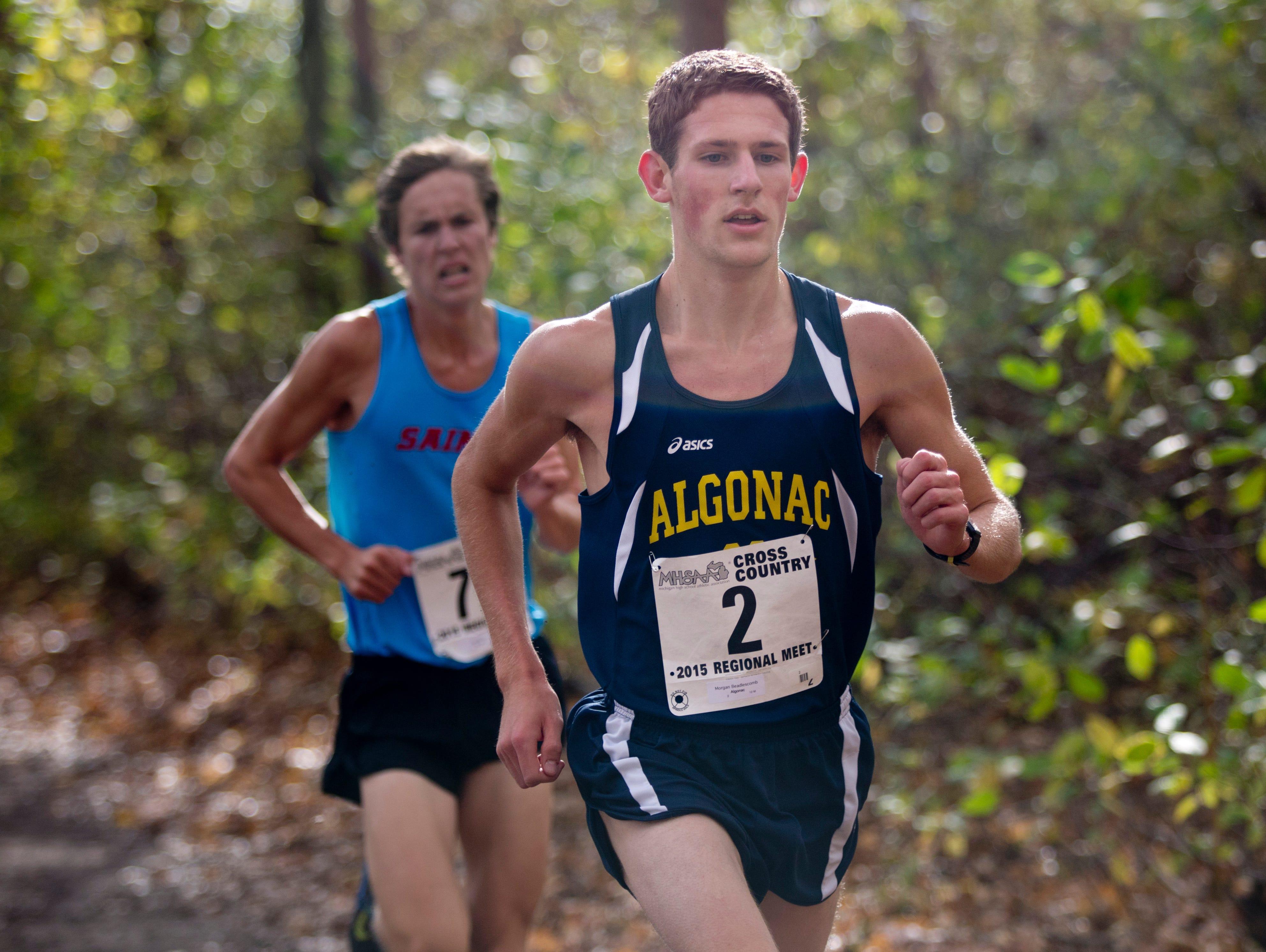 Alognac's Mogan Beadlescomb runs during a regional cross county meet Friday, October 30, 2015 at Algonac High School.
