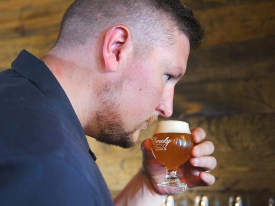 Matt Hastad, Remedy Brewing, smells a beer while he's