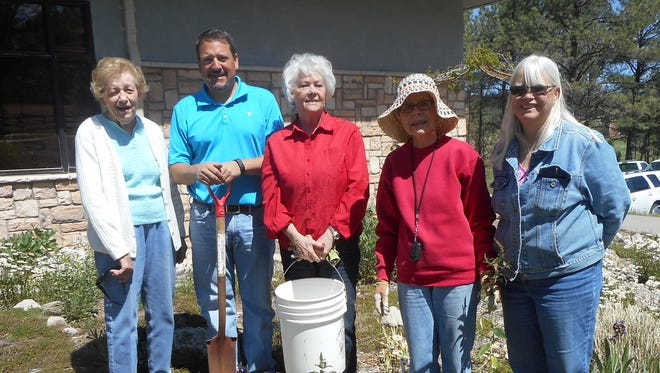 Lincoln County Garden Club planted a Butterfly Bush at the Ruidoso Public Library May 27.