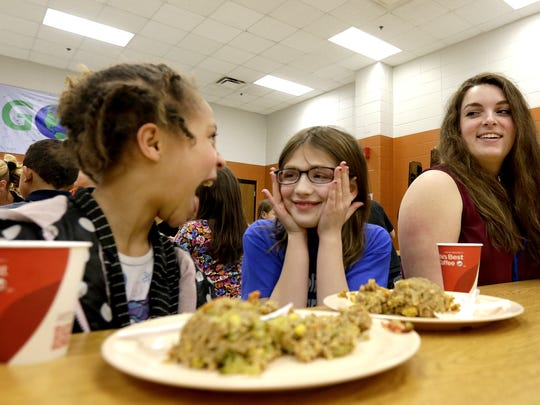 Lawrence University student Rachel Gregory talks Friday with Jorja Walker, left, and Lydia Centner, center, at the the Boys and Girls Club in Appleton. The students are part of a Lawrence program to collect unserved food at the university and redistribute it to local nonprofits.