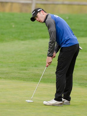 Salem's Robbie Hermes watches his putt Thursday at