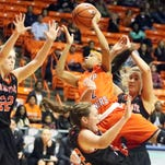 UTEP guard Jenzel Nash, 24, goes airborne during a drive to the basket for two points against Idaho State on Saturday night in the Don Haskins Center. Defending on the play was Jenna Morch, 32, of Idaho State.