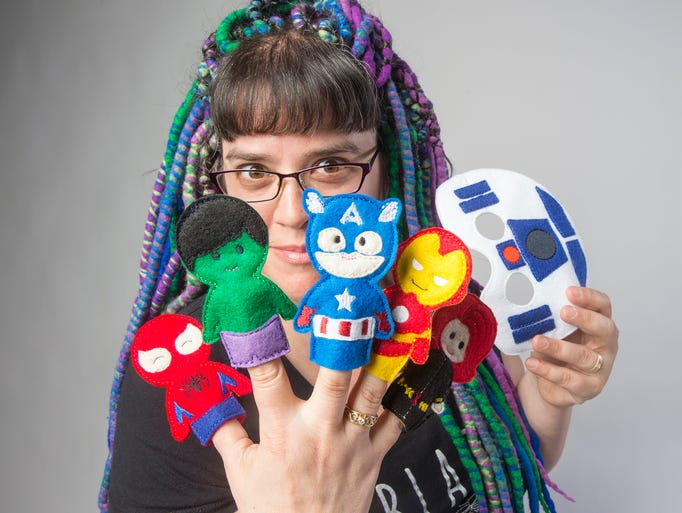 Emily Bowman with Tomboy Togs holds finger puppets