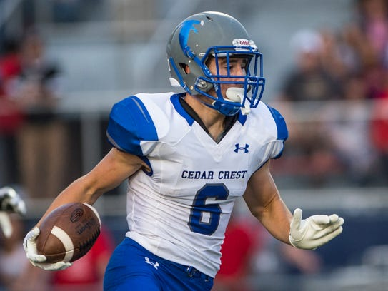 Cedar Crest's Tate Seyfert looks for running room during