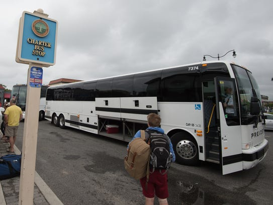 A bus operated by BestBus unloads visitors to Rehoboth