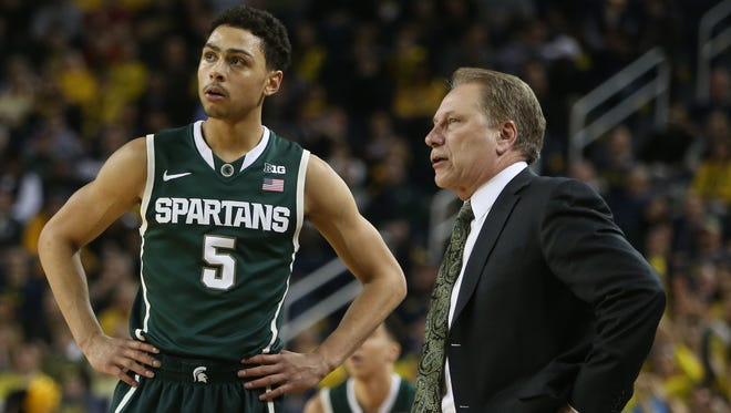 Michigan State coach Tom Izzo talks with Bryn Forbes during a timeout on Tuesday, February 17, 2015 at Crisler Center in Ann Arbor.