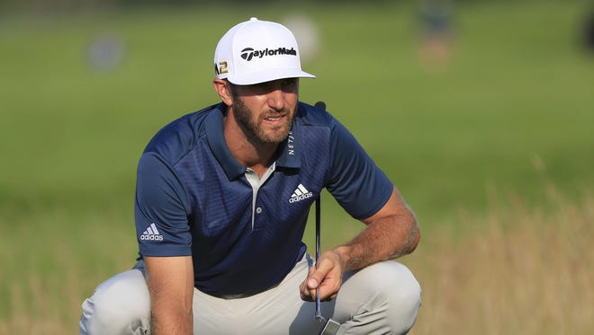 Dustin Johnson of the US lines up his putt on the fourteenth hole during the final round at 116th US Open Championship at Oakmont Country Club in Oakmont, Pennsylvania, USA, 19 June 2016. The tournament will be played 16 June thorough 19 June.
